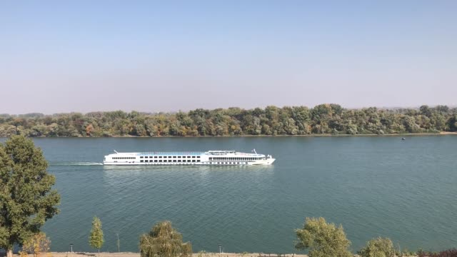 river cruise ship on danube on a sunny day - белград стоковые видео и кадры b-roll