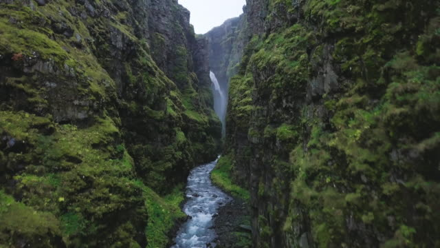 River in Icelandic Canyon A river at the bottom of a canyon on Iceland. Shot  in 4K resolution. rapids river stock videos & royalty-free footage