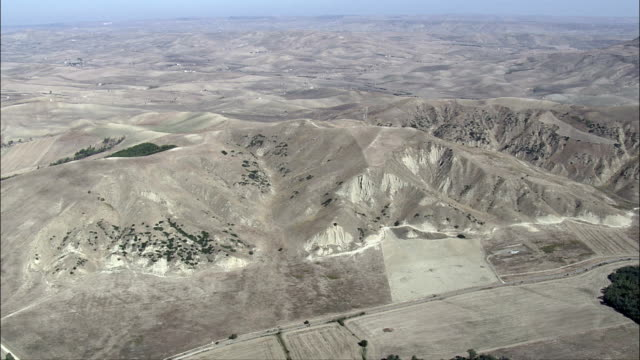 River Running through Parched Landscaped  - Aerial View - Basilicate, Italy video