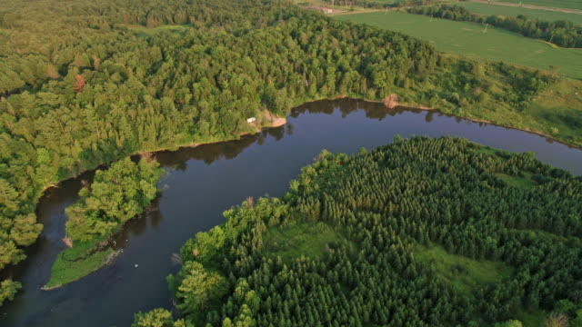 Video AERIAL River running through the countryside in Montreal, Canada