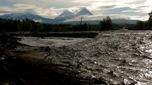 River Studenaya and Kluchevskaya group of volcanoes at dawn video