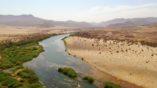 WS River through remote desert, Namibia, Africa River through remote desert, Namibia, Africa. Pan Up, Real Time. desert oasis stock videos & royalty-free footage