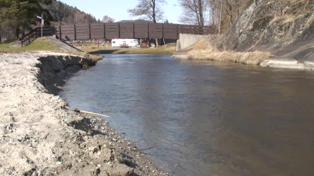 stockvideo's en b-roll-footage met river under the bridge. - caravan