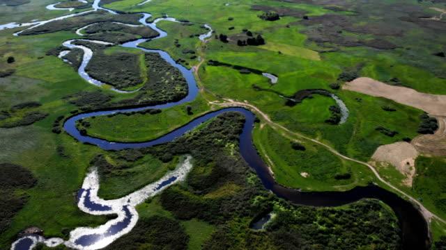 river winding among meadows - polska filmów i materiałów b-roll