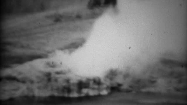 1937: Riverside geyser white steam smoke gas blows windy vapors. video