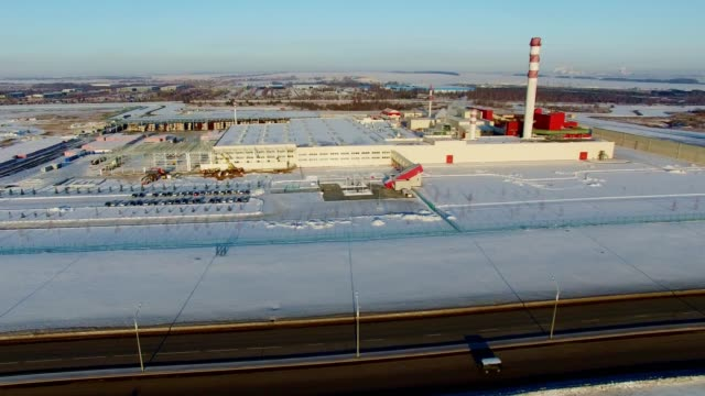 road at gas and oil refinery complex in winter bird eye view