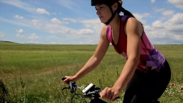 Road bicycle woman riding her bike video