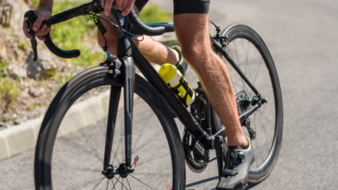 Road bike detail Road cyclists hands tightly gripping handlebar while cycling uphill endurance stock videos & royalty-free footage