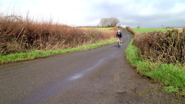 Road bike racer goes past fast video
