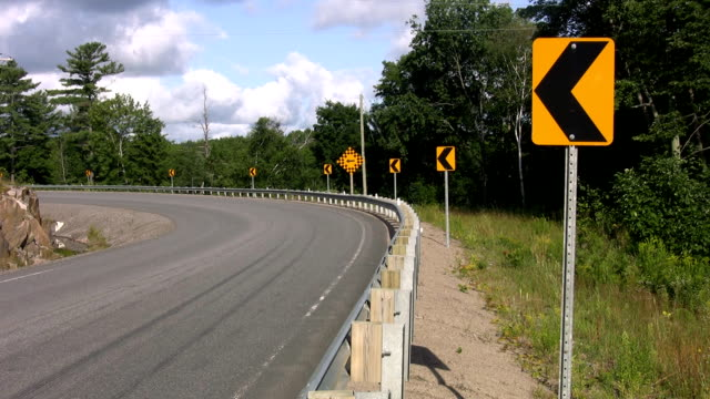 Road corner with yellow signs. video