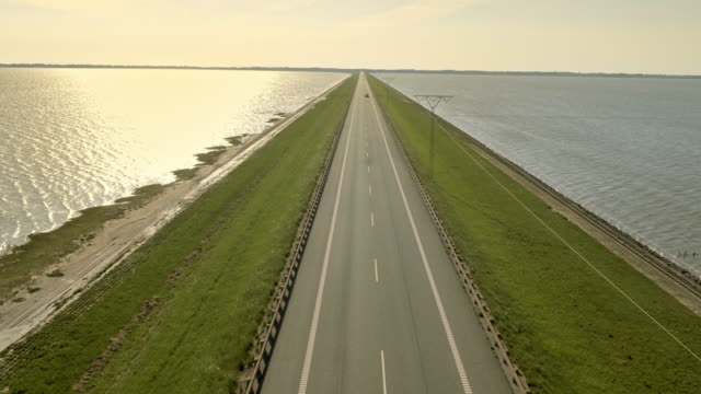 AERIAL Road crossing the sea on a dam video