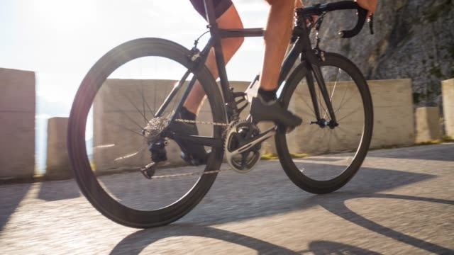 road cycling in mountains - bike tire tracks video stock e b–roll