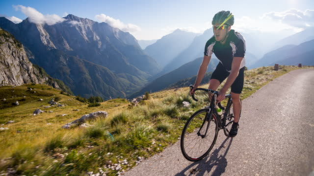 Road cycling on a mountain pass video