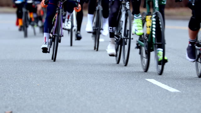 road cycling race in slow motion - evento ciclistico video stock e b–roll