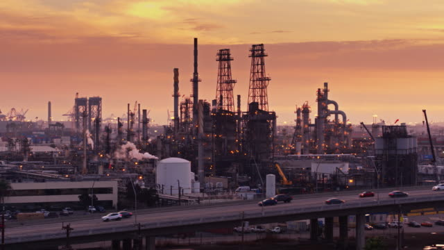 Road Passing in Front of oil Refinery at Sunset video