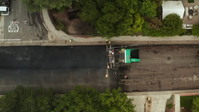 Road Paving on Residential Street Time Lapse - Aerial Drone Shot