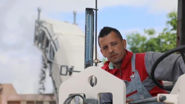 road repair. manual worker driving cold planer machine - man look sky scraper video stock e b–roll