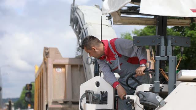 Road Repair. Manual Worker Driving Cold Planer Machine