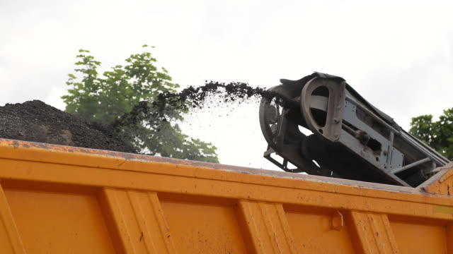 road repair. pavement milling. cold planer machine loading milled asphalt into dump truck - ghiaia video stock e b–roll