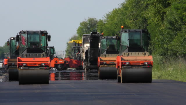 Road Roller Compacts the Asphalt video