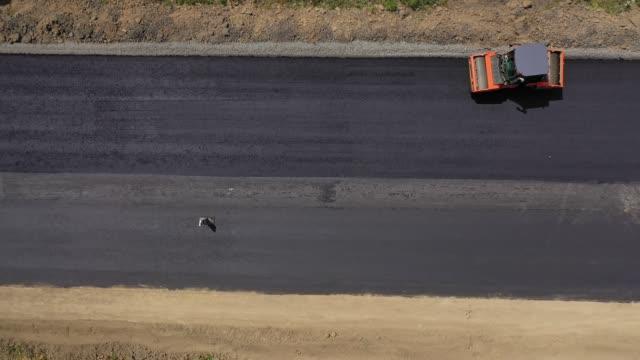 Road roller machine rolls asphalt