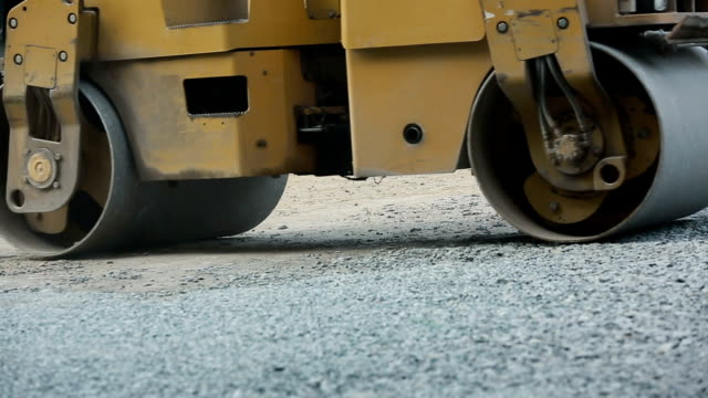 Road Roller Working On A Gravel video