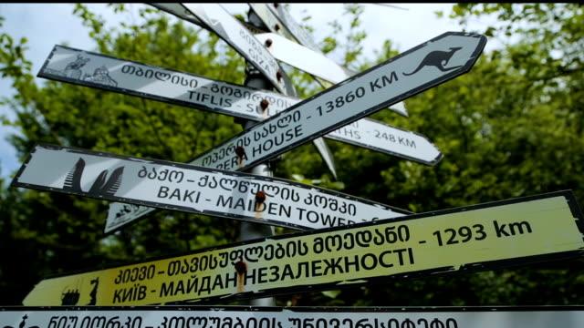 road signs in various languages in kutaisi georgia, travel destinations, tourism - юго восток стоковые видео и кадры b-roll