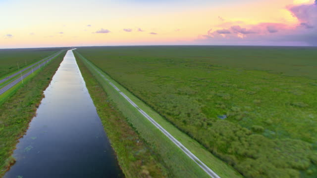 AERIAL Road through the Everglades in Florida at sunset