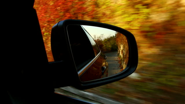 Road travel seen from side mirror with a autumn mountain Road travel seen from side mirror with a autumn mountain charming stock videos & royalty-free footage