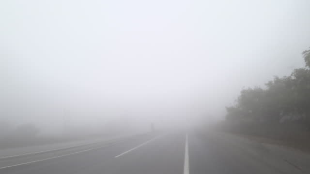 road trip in a foggy day from car point of view - intercity filmów i materiałów b-roll