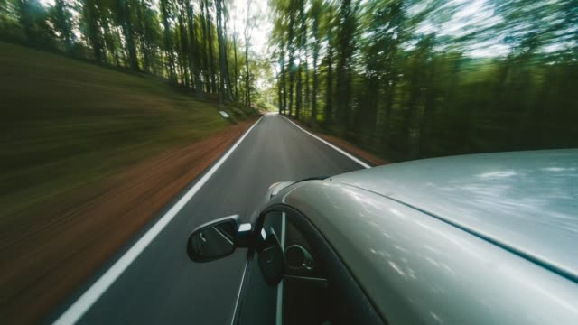 Road trip in the middle of the forest. Timelapse video Road trip in the middle of the forest. Timelapse video sports car stock videos & royalty-free footage
