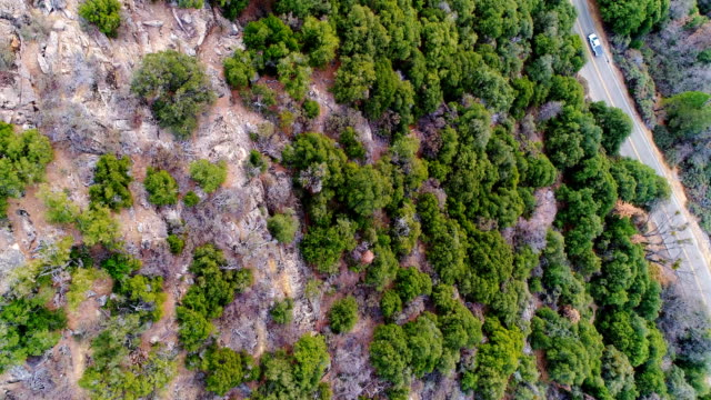 Road Road along mountain range. Aerial view. Cedarbrook, California california map stock videos & royalty-free footage
