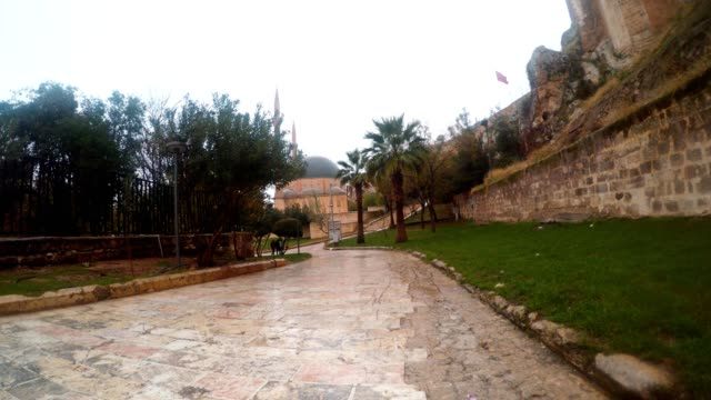 Road with Stone Tiles near Urfa Castle Far Mevlid-i Halil Mosque Snow and Rain video