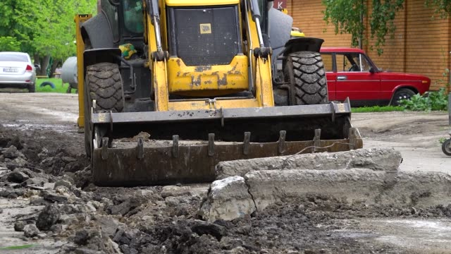 Road works with bulldozer removing old border video