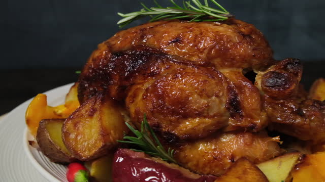 Roasted chicken or poultry with potatoes Roasted chicken or poultry with potatoes yellow peppers and rosemary. festive food restaurant home delivery. dish for family dinner or lunch Christmas New Year Thanksgiving. Holiday food recipe roast dinner stock videos & royalty-free footage