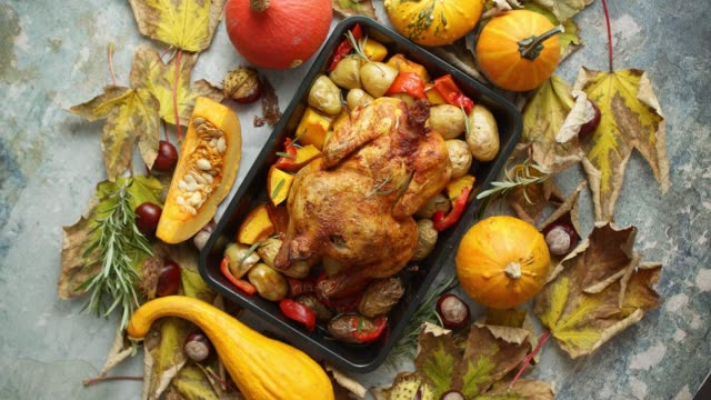 roasted chicken or turkey garnished with pumpkins, pepper and potatoes. served on a rustic table - thanksgiving background stock videos & royalty-free footage