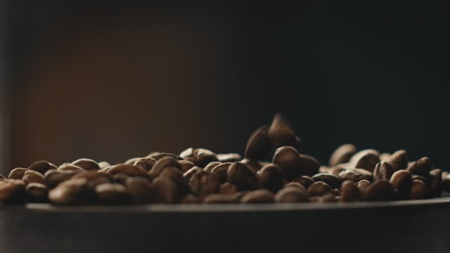 Roasted coffee beans falling in industry