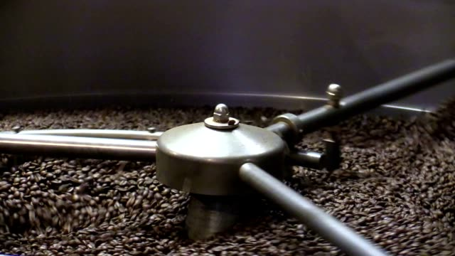 Roasted coffee beans in coffee roaster video