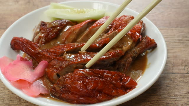 roasted duck meat and pickled ginger dressing sweet sauce picking by chopsticks