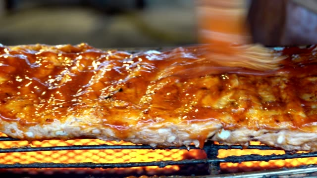 roasted pork ribs BBQ with barbecue sauce pan left to right