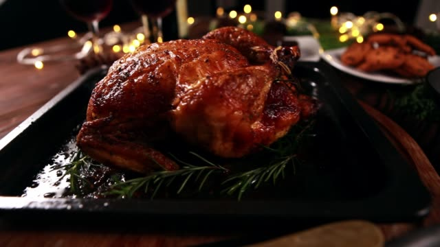 roasted whole chicken and other side dishes for festive dinner christmas new - cena natale video stock e b–roll