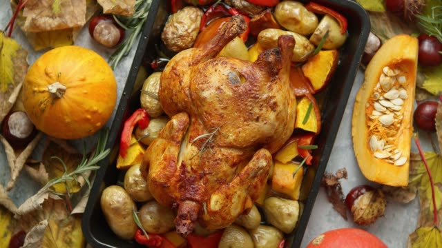 roasted whole chicken or turkey with pumpkins, pepper and potatoes. with colorful mini pumpkins - thanksgiving background stock videos & royalty-free footage