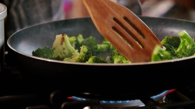 roasting broccoli in a pan for a bulgur dish - fine dining stock videos and b-roll footage