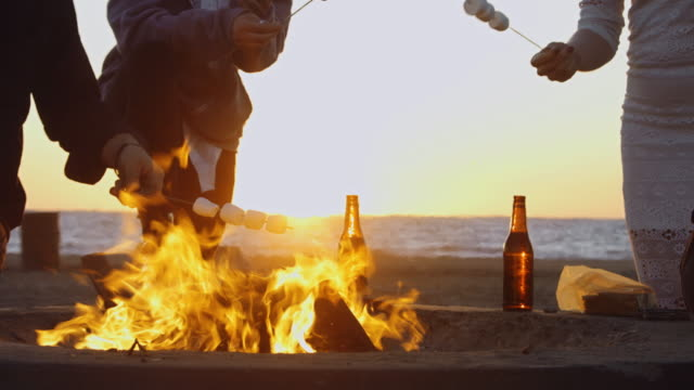 Roasting Marshmallows at Sunset - video