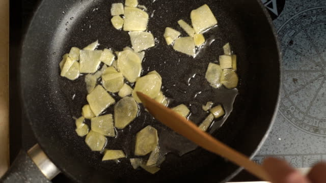 Roasting pieces of ginger in a saucepan in oil top view of the video video