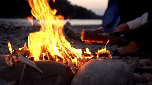 HD SUPER SLOW-MO: Roasting Sausages On Campfire video