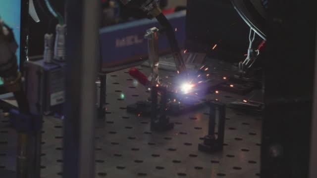 robot arm welding machine working in factories. - metal robot in logistic factory video stock e b–roll