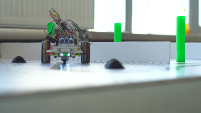 robot on wheels constructed by programmers at a robotics competitions. Education of children robot on wheels constructed by programmers at a robotics competitions. Education of children stem topic stock videos & royalty-free footage