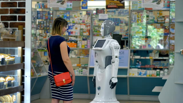 A robot shakes hands with a female customer. video