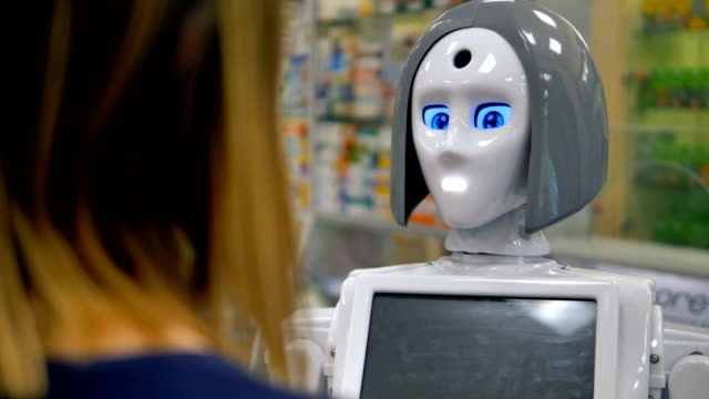 A robot talks to a female shopper. A robot answers  a female shoppers questions in a mall. robot stock videos & royalty-free footage